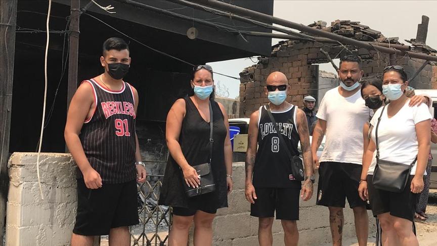 Gurbetçi aile Manavgat'ta evleri yananların yardımına koştu
